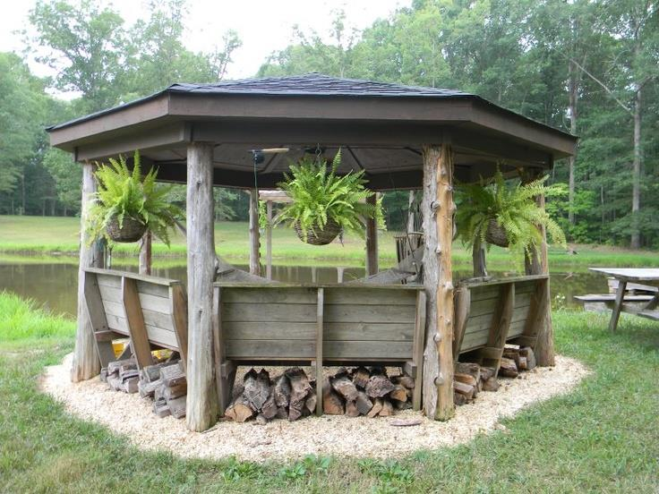 Rustic gazebo with potted ferns