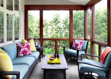 Screened-in porch with colorful throw pillows