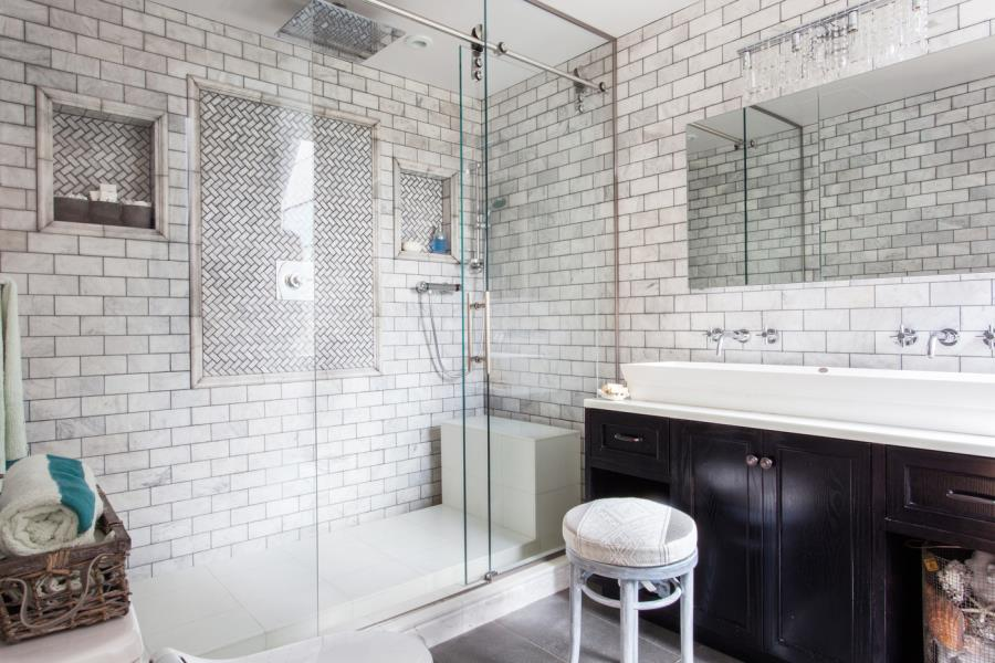 Shower with subway tile and glass doors