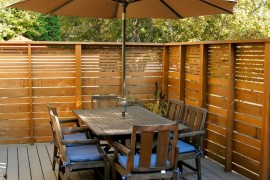 Slatted outdoor privacy fence