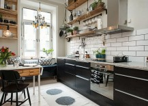 Small and stylish Scandinavian kitchen with breakfast nook and floating wooden shelves