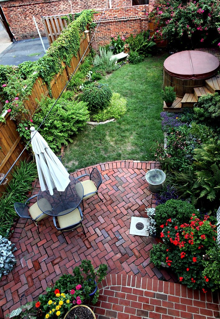view in gallery small backyard with a brick patio - Patio Brick Designs
