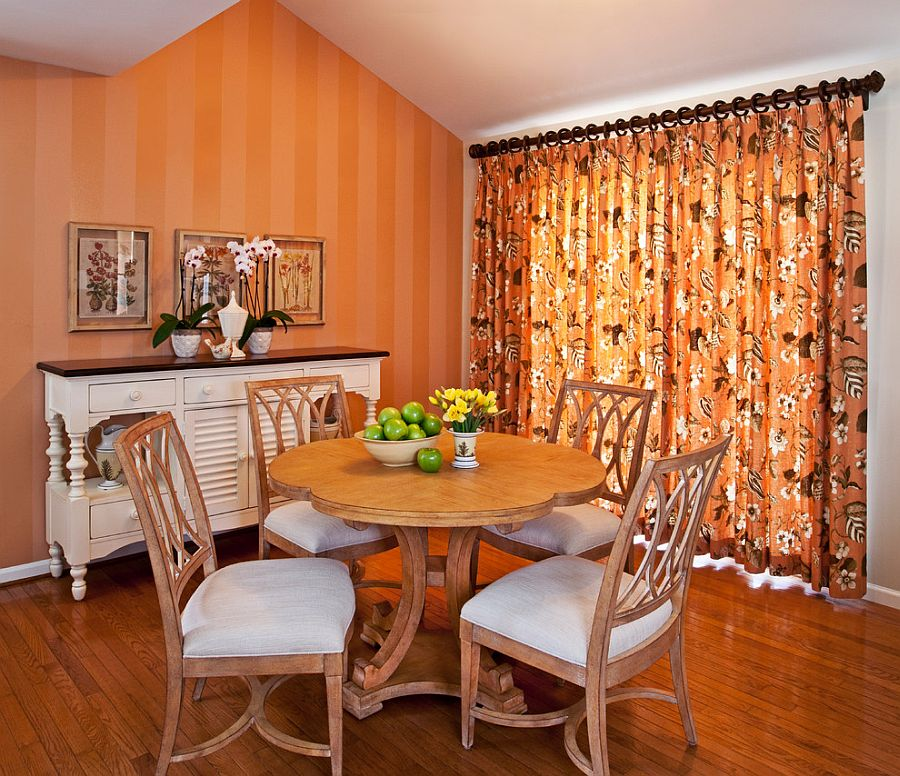 Small dining room with a warm invitinting ambiance How to Fashion a Trendy Dining Room with Spunky Orange