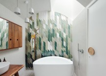 Snazzy green tiles used to create an awesome feature wall in the bathroom