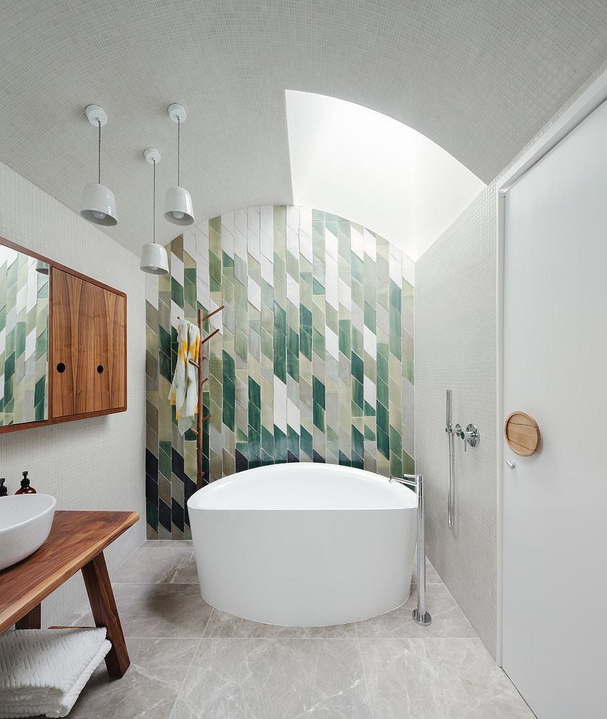 Snazzy green tiles used to create an awesome feature wall in the bathroom [Design: Day Bukh Architects]