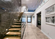Stunning-use-of-dark-wall-next-to-the-staircase-to-create-visual-contrast-217x155