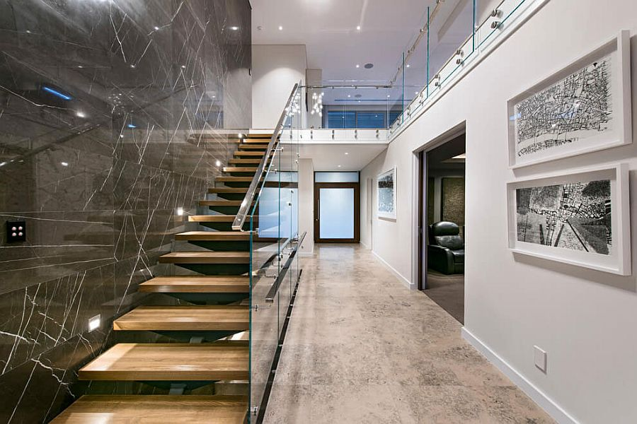 Stunning use of dark wall next to the staircase to create visual contrast