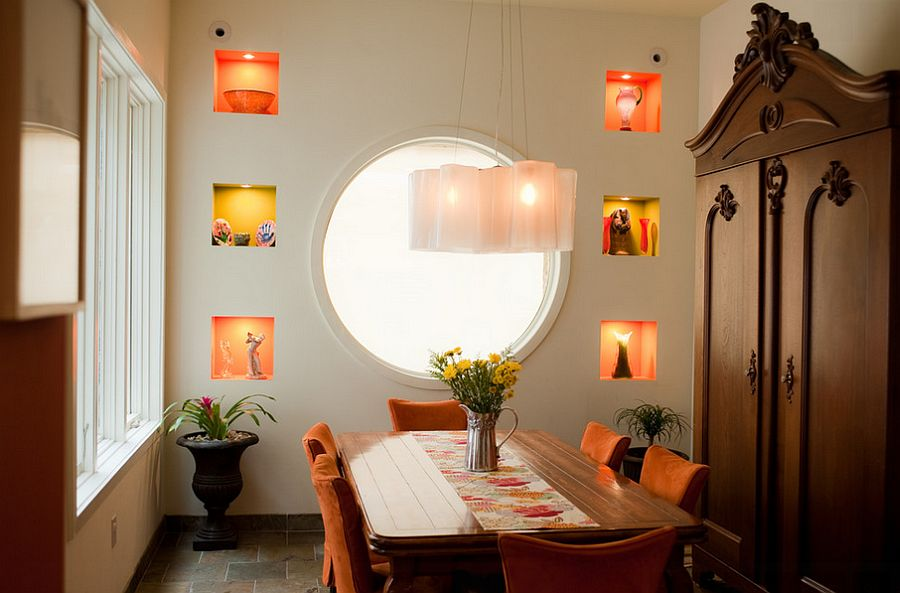 Subtle use of yellow and orange pops in the dining room [Design: Michele Plachter Design]