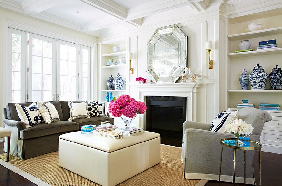 Tacked Ottoman steals the show in this glamorous living space [Design: McGill Design Group]