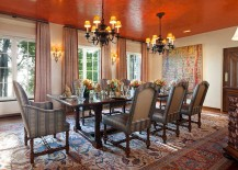 Textured orange ceiling becomes the focal point of this dining room