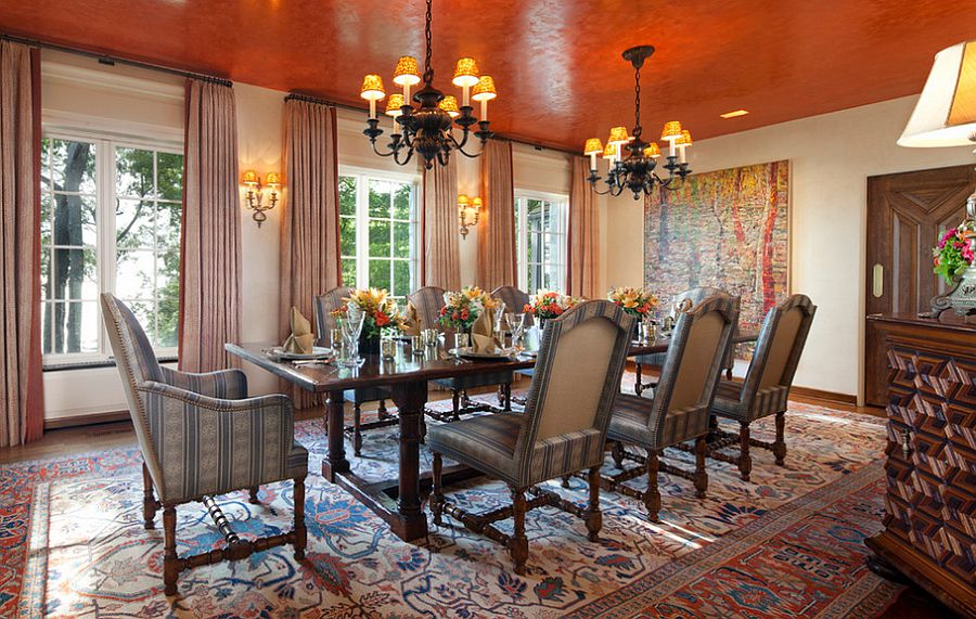 Textured orange ceiling becomes the focal point of this dining room [Design: Burns and Beyerl Architects]