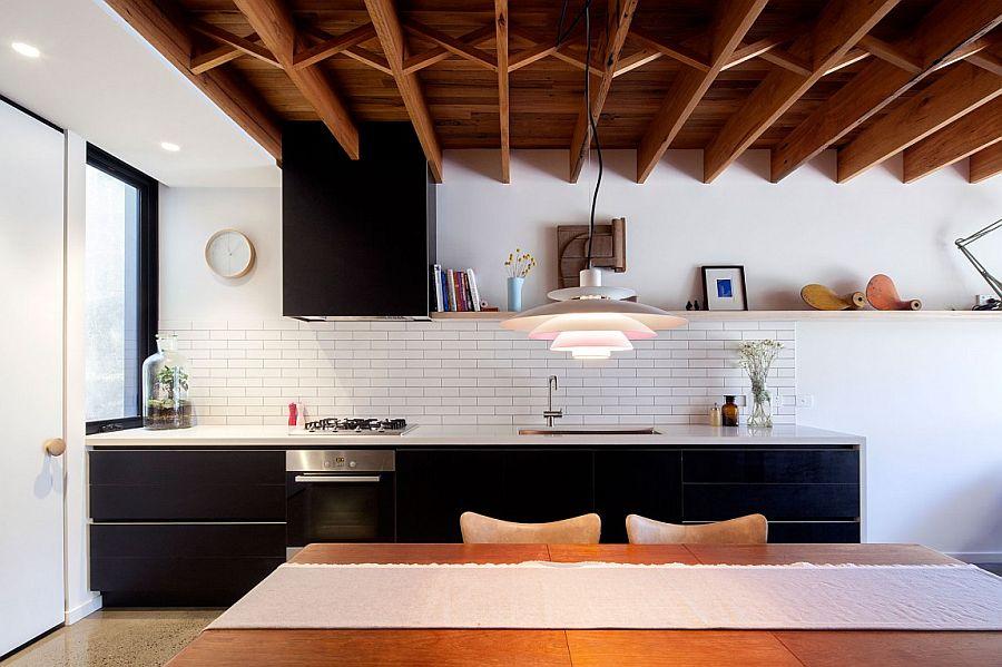 Tiled kitchen backsplash in white along with black shelves