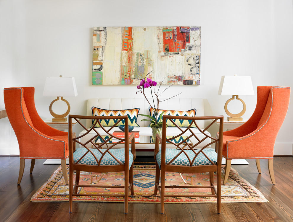 Transitional living room with pops of orange [Design: Leigh Olive Mowry-Olive Interiors]