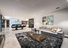 Trendy-living-room-in-neutral-hues-with-pops-of-yellow-217x155