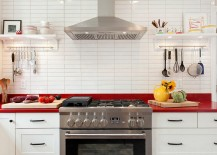 Unassuming-white-kitchen-with-a-classy-splash-of-red-217x155