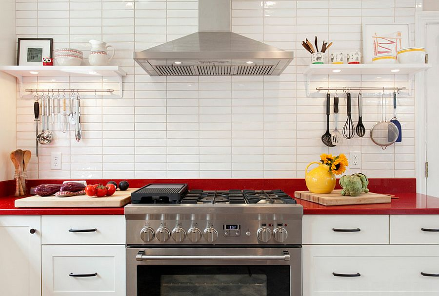 25 Captivating Ideas For Kitchens With Skylights: Unassuming White Kitchen With A Classy Splash Of Red