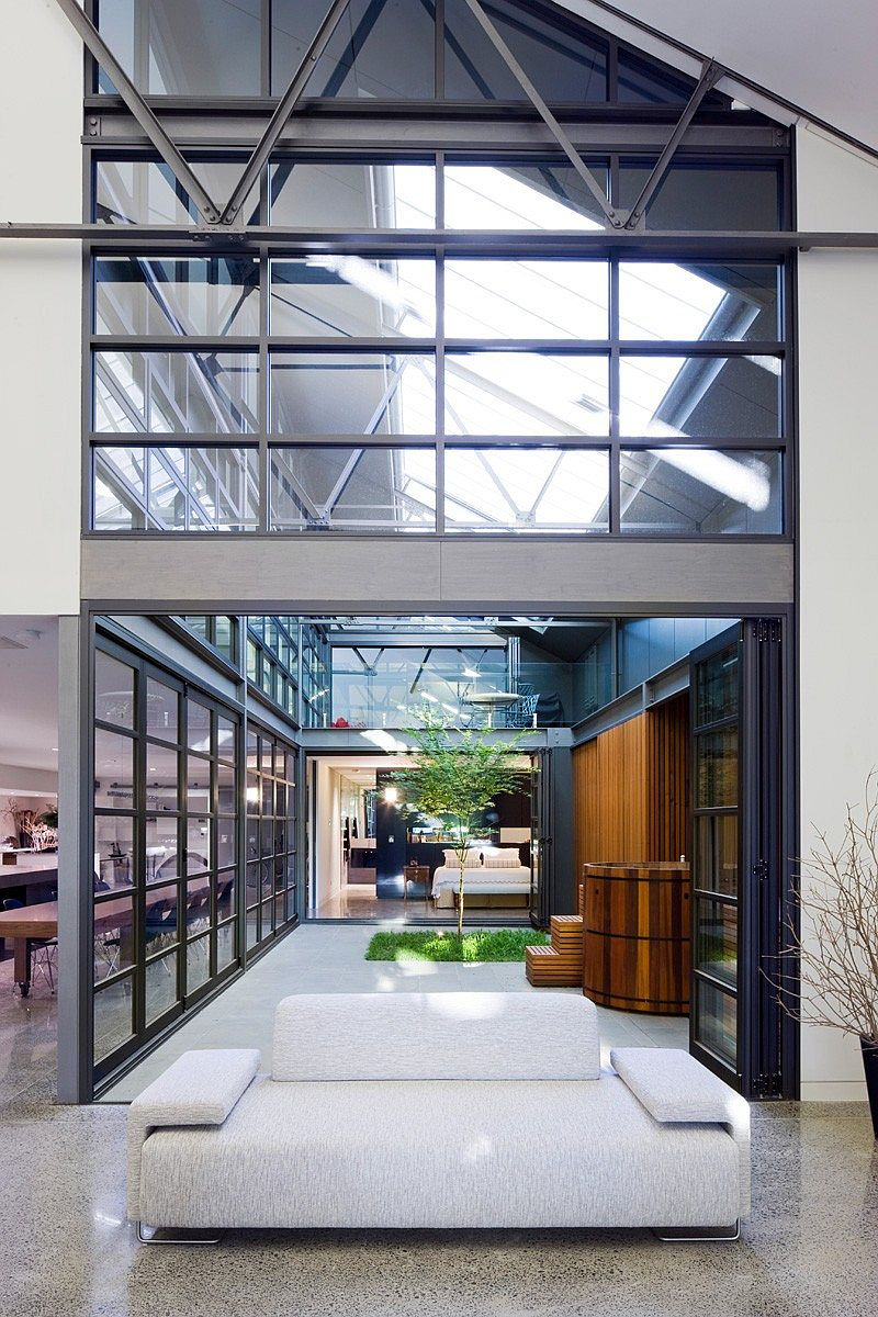 Unique courtyard design brings light and freshness into the industrial home