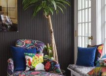 Vibrant patterns in a painted room with beadboard paneling