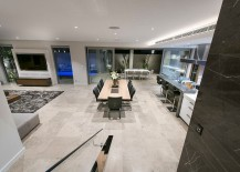View-of-the-lower-level-living-area-from-the-stairs-217x155