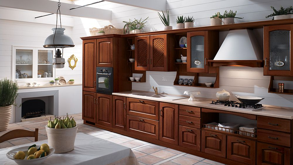 Walnut version of the Madeleine kitchen with its smart, space-saving shelves