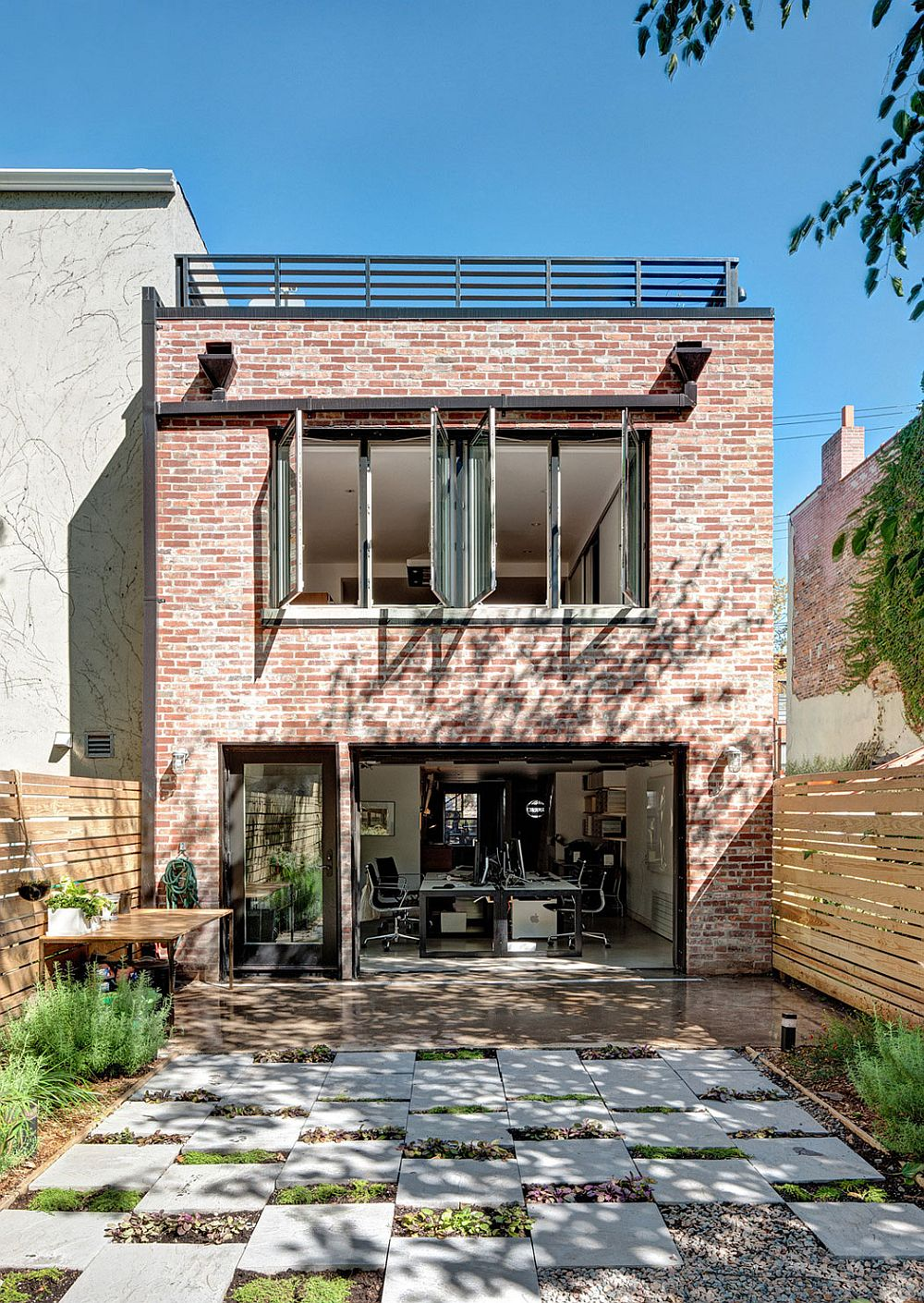 Weathered brick walls of the Brooklyn home gve it a timeless appeal