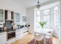 White-Scandinavian-kitchen-with-a-flood-of-natural-light-and-herringbone-floor-217x155
