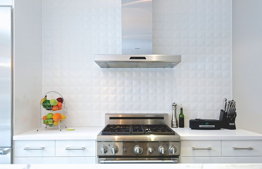 White ceramic tile backsplash in the kitchen adds depth to the setting [From: Andrew Snow Photography]