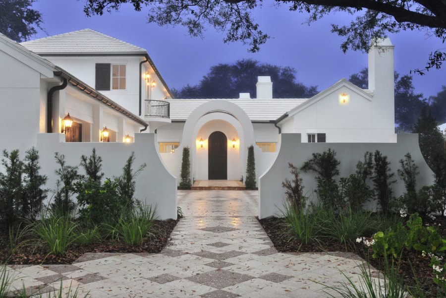 White stucco home with a front garden