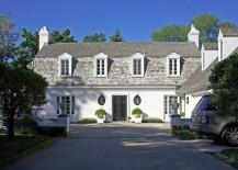 White stucco home with a shingled roof