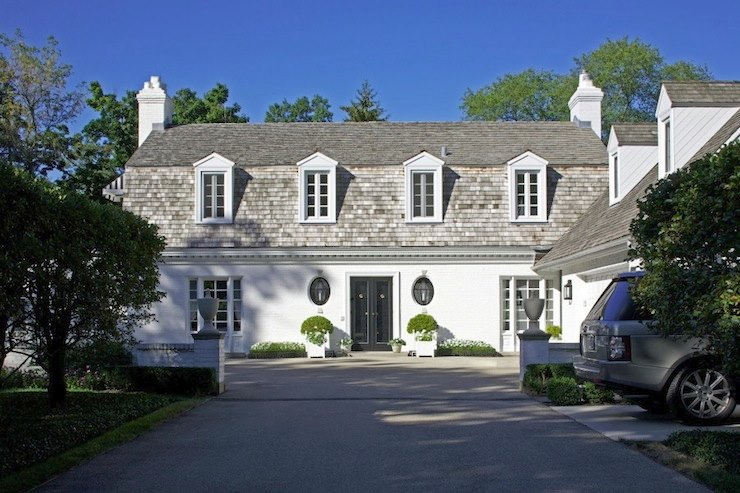 White stucco home with a shingled roof