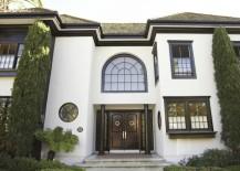White stucco home with dark trim