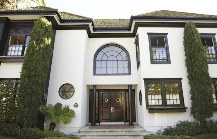 White stucco home with dark trim