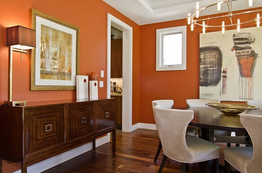 White trim brings elegance to the contemporary dining room in orange [Design: Ejay Interiors]