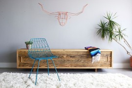 Wiry wall art in the living room in orange [From: Bend Goods]
