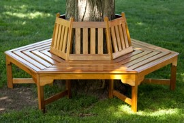 Wooden tree bench from Hayneedle  Tree Bench Ideas for Added Outdoor Seating Wooden tree bench from Hayneedle