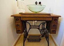 Old sewing machine used as DIY bathroom vanity