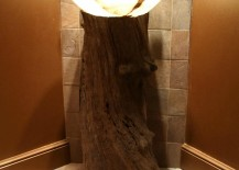 Gorgeous tree trunk bathroom vanity design with smart lighting