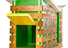 Bright and beautiful doghouse in green and yellow