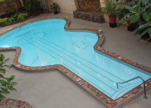 Guitar-shaped pool with strings and musical notes!