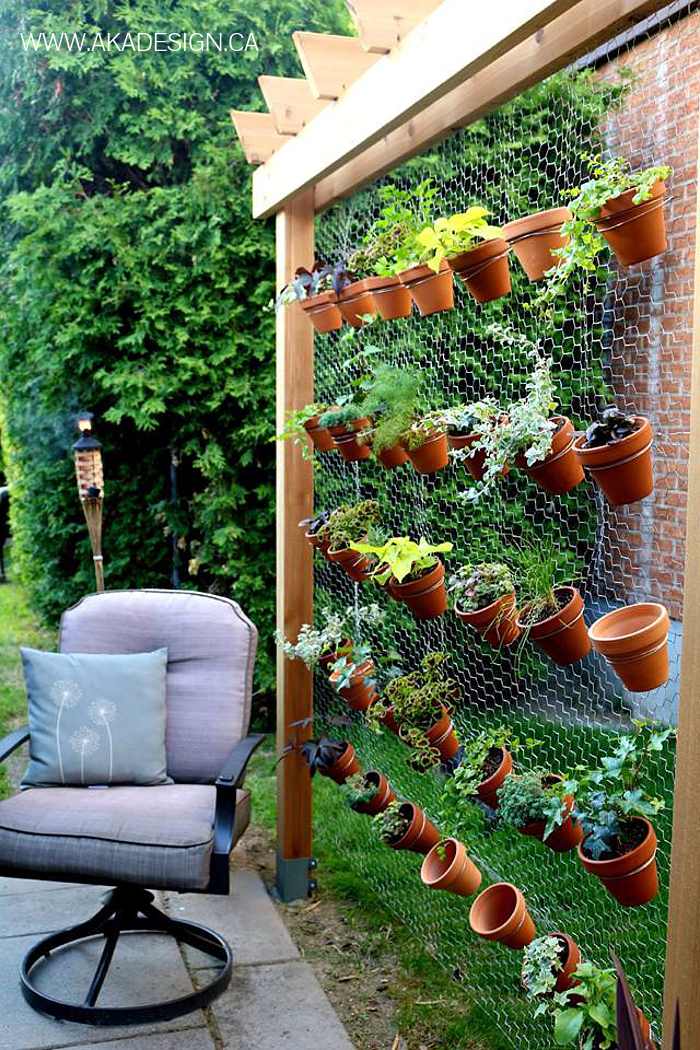 8 space saving vertical herb garden ideas for small yards for Balcony vertical garden
