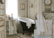 Black bathtub becomes the focal point inside this bathroom