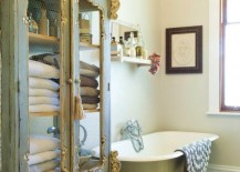 Gorgeous green and gold armoire inside the bathroom