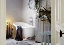 Large wall clock becomes a unique addition in this shabby chic bathroom