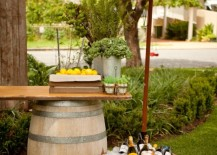 Relaxing outdoor lounge with wine barrels and umbrella