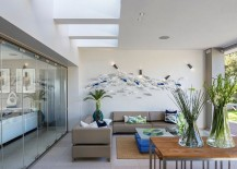 3D fish wall art for the sunroom with skylight [Design: C7 Architects]