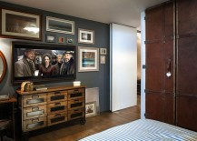 A gallery wall in the bedroom with television and vintage decor