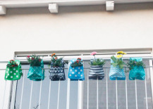 Adorable hanging planters in blue and green 217x155 Creative Outdoor Accessories to Hang from Your Balcony Railing