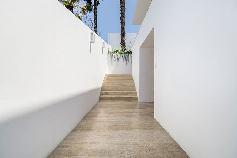 All-white exterior of the Peru home with narrow entrance