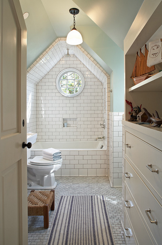 View in gallery Amazing white tile framed over bathtub. 15 Attics Turned into Breathtaking Bathrooms