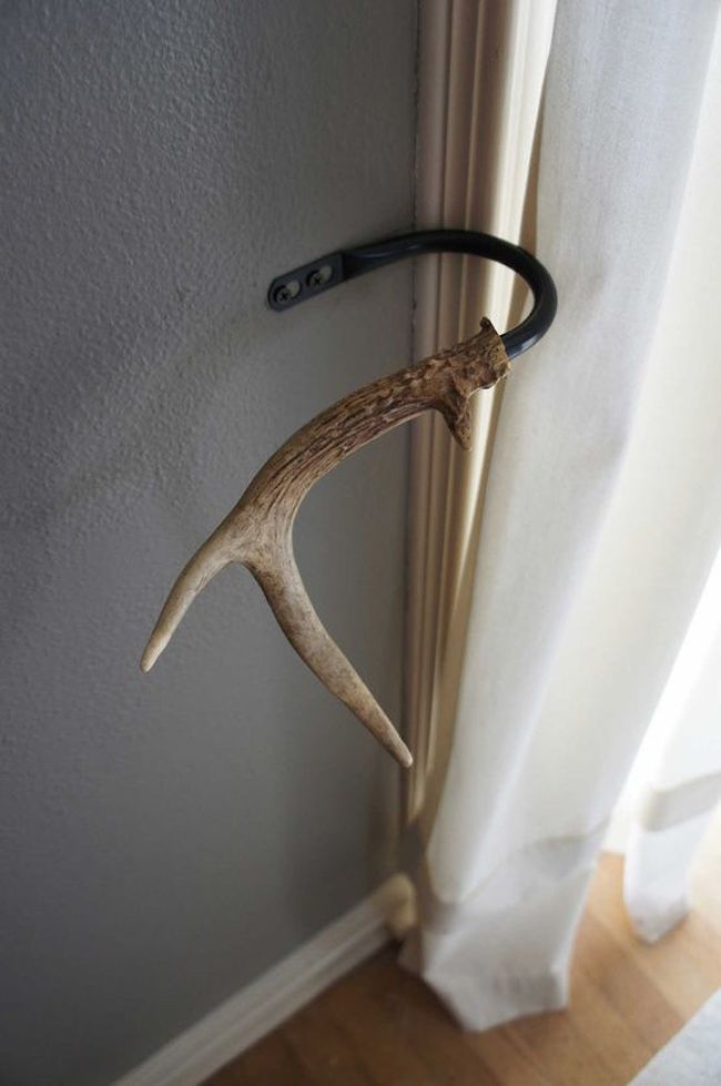 Antlers used as tie backs for curtains